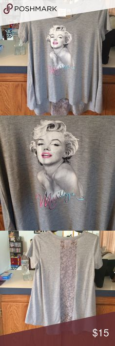 Marilyn Monroe lace back tunic tee Brand new, no tags. Never worn. Longer tunic length, fit is slightly over sized. Size medium. Super cute! Marilyn Monroe Tops Tees - Short Sleeve