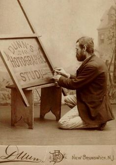 Sign Painter at Work - vintage photograph