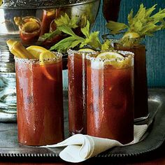 Bloody Mary Punch | Instead of stirring all the ingredients together, serve optional shots of vodka on the side, and let your guests add it or not. | SouthernLiving.com
