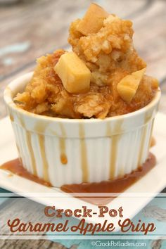 The quintessential fall dessert - Crock-Pot Caramel Apple Crisp is filled with warm apples, cinnamon & cloves, pockets of melted caramel & a crisp topping!