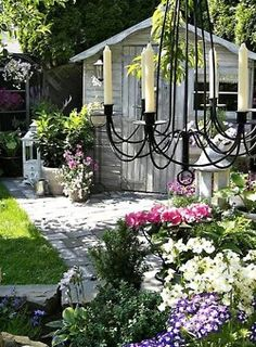I need a chandelier like that!  Romantic country garden :)