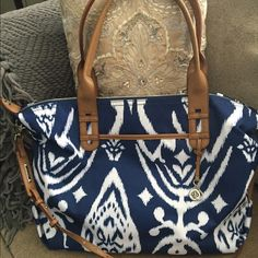 Stella & Dot Bag in Navy Ikat The 'How does she do it ' bag in a trendy navy Ikat print! This is a beautiful and functional bag in excellent condition. Only carried once for a couple of hours. No damage at all inside or out. The bag has great interior pockets as well as a good size water bottle interior side pocket area. Durable and wipe able exterior fabric with attention to detail in the hardware. Also comes with the cross body strap which was sold separately. Stella & Dot Bags Totes