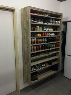 Pallet Furniture Projects Giant Shoe Rack Made Out Of Discarded Pallets Entrance Pallet Projects Pallet Shelves - This giant pallet shoe rack was made from discarded pallets and planks, roughly sanded, brushed and gray wash. Garage Organization, Garage Storage, Pallet Storage, Garage Shoe Rack, Shoe Storage In Mudroom, Cheap Storage, Woodworking Organization, Shoe Storage Ideas For Garage, Garage Shoe Shelves