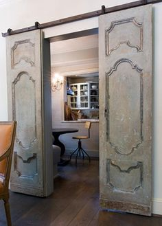 Vintage doors on door track hardware. So french country.