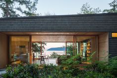 This wood filled holiday house, on an island in Washington State, is at home among the trees