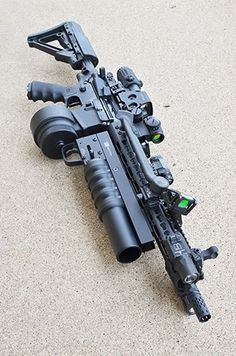 AR15 with M203, torch and 50 round Drum magazine