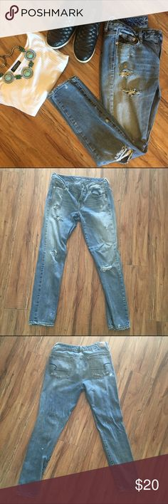 American Eagle Boy Jean Style 4L These jeans are lightly distressed with rips on the thigh and knee on both sides. The ends are also slightly frayed. The jeans fit in a mix of boyfriend and skinny jean style. They are a size 4 long. They have only been worn a few times. I have 2 pairs of this same jean.                               [Accessories not included] American Eagle Outfitters Jeans Skinny
