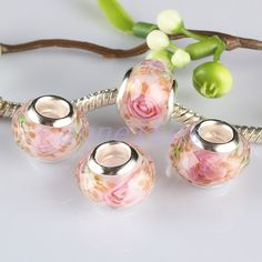 I have one pink murano glass bead, but its not as pretty as these in the picture. I would like to have another pink glass bead for my Pandora to balance it out.