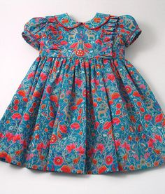 "Bloom"" Front Frill Dress -Liberty ""Palmeira Bloom"" Front Frill Dress - Liberty Tana Lawn Dress in navy blue ""Edenham"" print for A Little Girl Ladybird Girls Ditsy Floral Print Dress Girls Frock Design, Kids Frocks Design, Baby Frocks Designs, Baby Dress Design, Baby Girl Frocks, Frocks For Girls, Little Girl Dresses, Baby Dresses, Cotton Frocks For Kids"