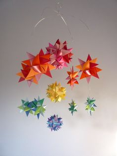 Origami mobile! http://www.etsy.com/listing/68356600/baby-crib-mobile-hanging-origami-stars