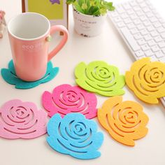 Rose shape wool felt coaster. Bright colors and hollow design wool felt coaster. heat insulated and decorative wool felt coaster.