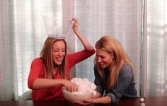 """Ok - here's something really fun for you to do with your kids. It's called the cotton ball challenge and it's SUPER EASY! You only need three things:  Two bowls A spoon  Boom. Watch the video to see how to play. If you are playing with small ones, you might want to use a blindfold as well because the temptation tocheat might be too great. Heck, I almost cheated! Audrey and I had a big LAUGH. It's a great""""minute to win it"""" game for friends as well. Follow our YouTube channel for more ideas!"""