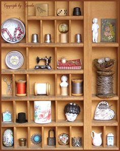 Cabinet of curiosities I'm in love with tiny sewing items and bisque doll parts, nests amongst many other things Sewing Room Decor, Sewing Room Organization, Sewing Rooms, Coin Couture, Wal Art, Vitrine Miniature, Shadow Box Art, Vintage Sewing Notions, Cabinet Of Curiosities