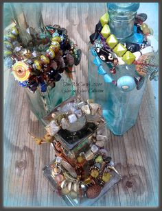 Glass on Glass: Collections of Bracelets displayed on glass bottles...by Toni McCarthy 2014