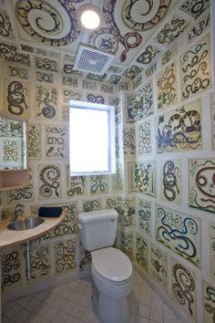 Bathroom is papered in Alburtus Seba's Cabinet of Natural Curiosities.