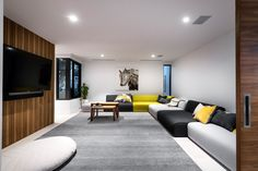 Relaxed living space with feature timber wall designed and built by Urbane Projects. Timber Walls, Sofa, Couch, Stone Flooring, Wall Design, Living Spaces, Coastal, Bedroom, Building