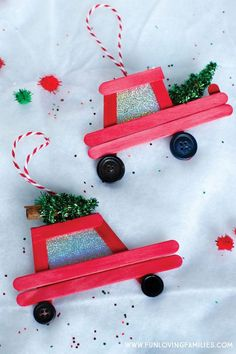 Car and Truck Popsicle Stick Christmas Ornaments DIY popsicle stick Christmas ornaments: How cute are these little red car and truck DIY ornaments! Click through for the easy step-by-step tutorial.DIY popsicle stick Christmas ornaments: How cute are. Diy Christmas Ornaments, Christmas Art, Christmas Holidays, Popsicle Stick Christmas Crafts, Popsicle Stick Art, Ornaments Ideas, Diy Christmas Frames, Diy Ornaments For Kids, Popsicle Stick Picture Frame
