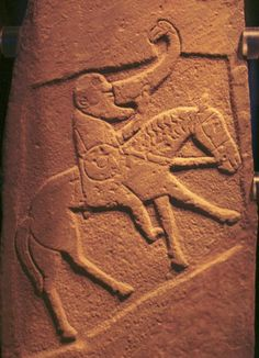 Bullion Pictish Stone.   This Class III stone, found in 1933 during road construction, is now in the Museum of Scotland in Edinburgh.