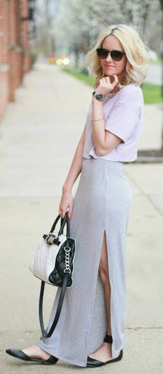 Gorgeous grey slit maxi skirt with top cropped blouse and leather black  white hand bag and black leather shoes and goggles the best way to show fashion  style