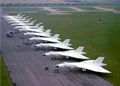 Six Avro Vulcan aircraft of No 617 squadron and six Handley Page Victor aircraft lined up at RAF Scampton. Military Jets, Military Aircraft, Vickers Valiant, Handley Page Victor, War Jet, V Force, Avro Vulcan, Bomber Plane, Commonwealth