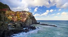 The pastel buildings in the Cinque Terre town of Manarola brighten up the craggy Italian coast. (From: 12 Most Colorful Towns in the World)