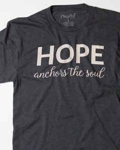 """This is a super-soft unisex tee with our """"HOPE anchors the soul"""" design. Fit: Unisex and runs true to size. *Vintage black with a soft peach design. Size Bust/Chest Inches XS 30-32 Small 34-36 Medium"""