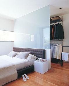 With a wall that thin you might be able to do a walk through closet?