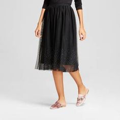 Flutter through your days and nights in subtle sparkle with the Embellished Tulle Skirt from A New Day™. This black midi skirt brings the sweetest style with the flowy tulle construction and sparkly rhinestone embellishments along the bottom. Just pair this skirt with a fitted black top for a look that can easily go from day to night.