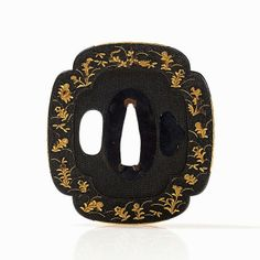This rich ornate shibuichi Tsuba originated in the Japanese Edo period (1603-1867). The tsuba has a squared mokko form, bearing a fine nanako ground, where numerous floral sprigs on both sides are visible. The blooming flower border and the elements on the outer edge are unique due to the finely crafted gilt inlays in hirazogan. A closed and an open recess can be detected in addition to the central slot.  The dimensions are 7 x 6.5 cm