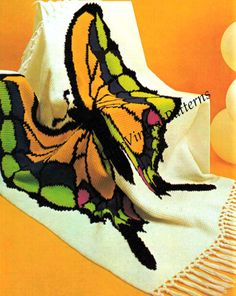 Crochet Afghan Butterfly Rug Pattern really appeals to the eye.Great tutorial..Love the bright cheery colors.
