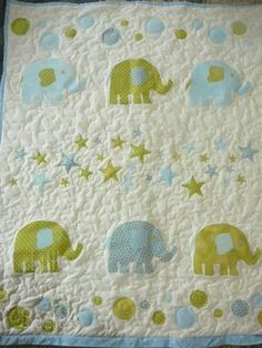Sigh ... I want to learn to quilt so bad and make this super adorable elephant quilt for someone's baby!