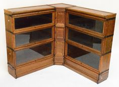 A rare Antique Oak Corner Globe Wernicke Barristers bookcase.  These always seem to come in a stack of 3 shelves.  Other examples have the corner section glazed - but on this example it is wood fronted. Nice example.