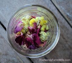 jar with rose petals and helichrysum flowers