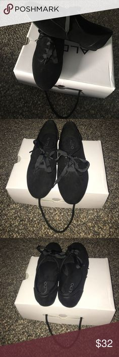 Never Worn!!! Aldo's Lace-Up Flats These shoes have never been worn! In very good condition! They are lace-up flats and are in all black. The size is an 8.5. The material of the shoe is a suede and the laces are not. The bottoms are a rubber material and have a small heal, probably about 1 inch. I'm sure they can go with any outfit! Either casual or dressed up🤗 Unfortunately they do not come with a box, but I will be sure to wrap them carefully! If you have any further questions, please…
