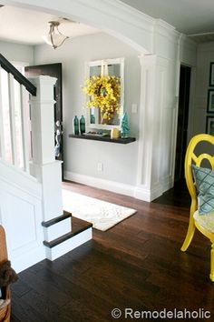 AFTER shot of a home that previously lacked an entryway before they added the arch, column detal and redid the stairs - GORG