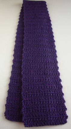 Lazy River Scarf: Alternating bands of K1P1 ribbing & garter stitch, two of the most basic stitches. They effortlessly create this wavy fabric with rippled edges. Reversible.