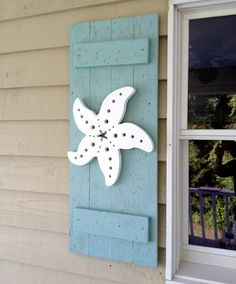 This is what I want when we re-do the house. I am tired of the flamingo's. starfish shutter