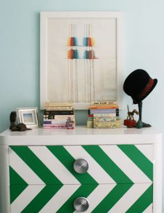 Nick Olsen painted this flea market chest shiny white Rustoleum and then added the green chevron pattern.