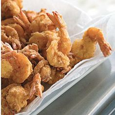 Bayou Fried Shrimp | Cajun seasoning and fish fry mix make an easy, flavorful breading for fried shrimp. Dip in tartar or cocktail sauce. Mix a package of shredded coleslaw with a simple dressing an easy side. | SouthernLiving.com
