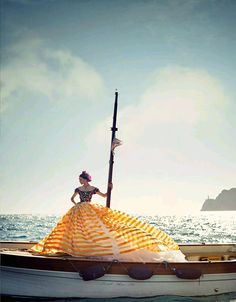 A luscious yellow dress, a boat, and the sparkling sea. What more could a girl ask for?