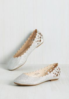 Above and Beau Monde Flat in Silver. These lovely, laser-cut flats have halted your search for the perfect footwear - what luck! #silver #wedding #modcloth