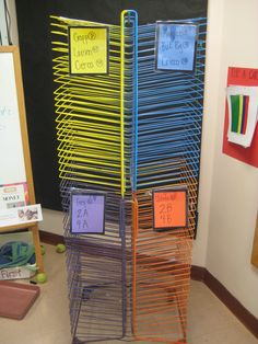 My drying rack was originally all light blue.  I teach four classes a day, so I divided it up and spray painted each section to keep my student's artwork better organized.