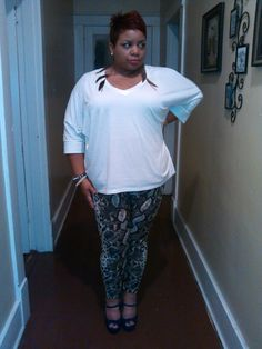 Just me in an Ashley Stewart top & snake print leggings. Feather drop earrings & peep-toe Mary Jane wedges.