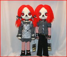 Inspired by classic Raggedy Ann & Andy, these two tattered rag dolls are completely hand stitched, stand 22 inches tall, have vintage button eyes,