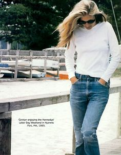 Carolyn Bessette Kennedy in vintage Levis and white long sleeve tee.
