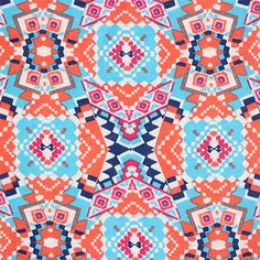 "Blue Coral Ethnic Kaleidoscope Cotton Jersey Blend Knit Fabric - A slub poly cotton rayon blend knit with a unique kaleidoscope design in colors of coral, dark and light blue, and fuchsia pink colors on a white background.  Fabric is light to medium weight, with a small stretch.  Pattern repeat measures 8 3/4"" (see image for scale).  ::  $6.25"