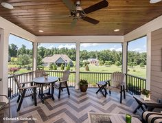Wood paneling tops the ceiling of this rear porch. Home design #1290, The Chesnee.