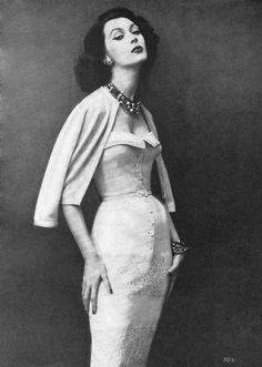 Dovima modeling a Frederic Harvey dress, 1957.