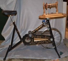 Spinning wheel made from an old exercise bike. That's one way to multitask! Exercise and spinning! Worth looking into!