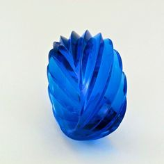 "A splendid bright true blue bangle bracelet that has no competition! This vintage bangle bracelet is deep sky blue lucite in a swirled, pleated design. Produced in Western Germany, these bracelets are found in a variety of opaque and translucent colours. It's an impressive size at over 1/2"" thick and 1 5/8"" wide (2 3/4"" inner diameter)."